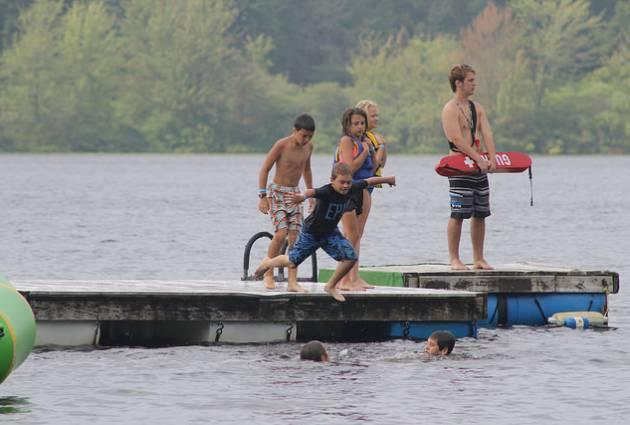 warner-camp-kids-jumping-lake